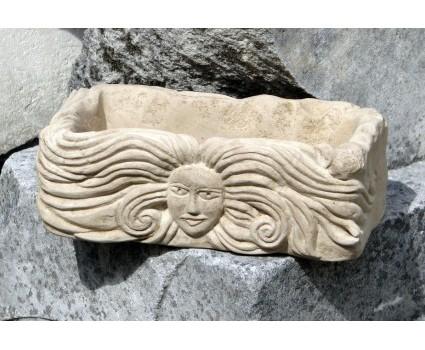 vasetto in pietra con faccina